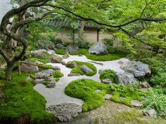 Islands and mounds created around a stone swale in a japanese garden.