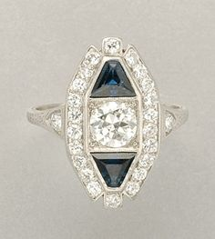 Diamond and Sapphire Ring   Platinum, one diamond ap. .70 ct., 24 diamonds ap. .75 ct., c. 1930, ap. 3.5 dwt.