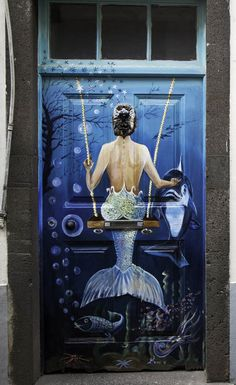 Painting on a door in the streets of Funchal on the Portuguese island of Madeira