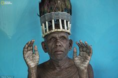 The chief of Ramnami people in Chhattisgarh, India, displays extensive tattoos of the name of their god in this photo fromMattia Passarini
