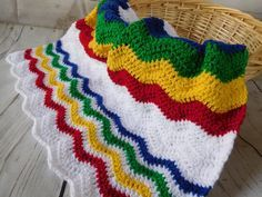 Rainbow crochet blanket. Colorful baby afghan. This is a very special handmade crochet baby blanket.  This baby afghan will make a wonderful baby shower gift.  This is a chevron type pattern but with more of a ripple effect.  This blanket would make a lovely addition to your baby nursery decor. Perfect also, for travel, strollers, prams, cribs, tummy time and photo props