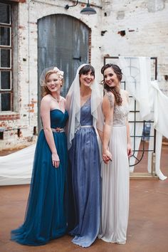 Lovely bridesmaids in stunning shades of blue and gray from BHLDN