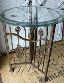 Table made out of an old iron gate