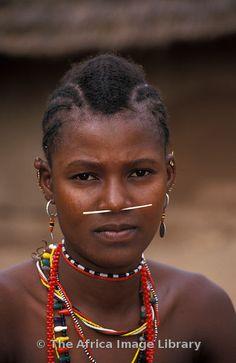Africa   Bedik woman with porcupine coil through her nose, Iwol, Bedik village, Bassari country, Senegal   © Ariadne Van Zandbergen
