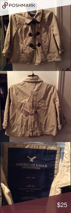 American Eagle Medium Tan Toggle Closure Jacket American Eagle Jacket with toggle loop closures. 3/4 Sleeves. Size medium in great preowned condition. No stains or holes. Feel free to bundle or make an offer American Eagle Outfitters Jackets & Coats