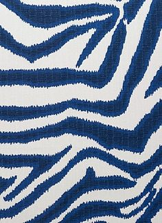 """Zebra Ikat Marina White -  Large scale zebra print on durable linen weave texture fabric. Perfect for window treatments, pillows, cushions, room dividers, table toppers, bedding, headboards and furniture upholstery. Content; 100% cotton. Repeat; V 25.19"""" x H 27.00"""". 15,000 DOUBLE RUBS. 55"""" wide."""
