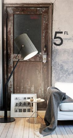 This metal, industrial style door works in this space! Tone is important. Antiqued doesn't have to mean heavy & ornate.