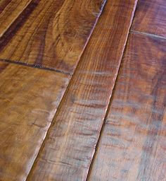 This is actually a hand scraped Walnut wood floor by Pennington Floors.  Check out our other pins for a Faux Wood look in tile!