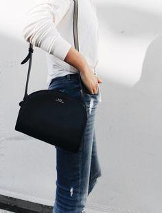 A.P.C. half-moon bag & Common Projects sneakers. Via Mija