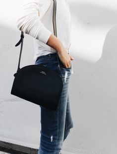 A.P.C. half-moon bag & Common Projects sneakers. Via Mija