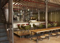 in Cape Town so here's a steampunk-inspired coffee shop in the city by South African designer Haldane Martin.