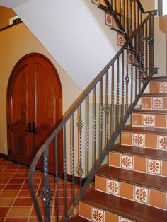 Spanish tile shown in Saltillo Terracotta floor tile and Talavera Mexican painted ceramic tile on the stair risers