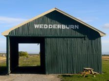 Wedderburn Station goods shed has been  returned to its original site