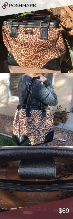 Rare NEW GIGI HILL Leather Cheetah Shoulder Bag Rare new Gigi Hill leather cheetah bag. Lots of pockets, Holds pleanty with a kefob and cell phone holder. lined in vinyl perfect for busy fashion ladies afraid of spills. Approx measurements 14 x15 inches 11 inch handle drop. gigi hill los angeles Bags Shoulder Bags
