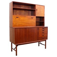 Peter Hvidt, Cabinet for Soborg Mobler, 1960s. I put it in this category because my parents had a similar one, and the pull-down part was actually a desk. The top and the bottom would be separate cabinets (instead of a single piece).