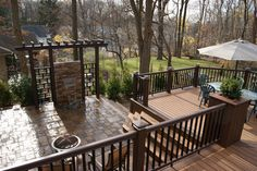 Liquid Light Timbertech deck & Hardscape w custom waterfall privacy wall eclectic patio