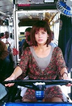 "Sandra Bullock driving the bus that could prove deadly in the 1994 hit movie ""Speed. Sandra Bullock Speed, Sandra Bullock Legs, Sandra Bullock Movies, Sandro, People Magazine, Famous Women, Famous Girls, Mode Vintage, Keanu Reeves"