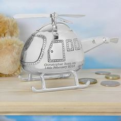 This silver plated Helicopter Personalised Money Box can be engraved with any message over 2 lines and up to 20 characters per line. All personalisation is case Personalised Money Box, Personalised Christening Gifts, Personalized Baby Gifts, Personalized Christmas Gifts, New Baby Gifts, Gifts For Boys, Baby Christening, Boy Birthday Parties, Gifts For Wedding Party