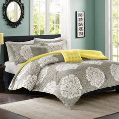 Refresh your master suite or guest room in natural style with this lovely comforter set, showcasing a floral motif in gray.  Product...