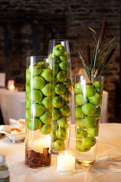 Fall wedding with different green apple arrangements.   Photo by: Sam & Mary Photography.
