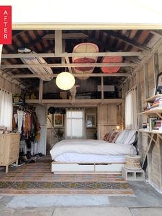 """When roommates outnumbered bedrooms, Brooke opted to take the garage. Now that she cleaned it, cleared it, and spruced it up, we bet the others are super jealous of her fab """"glamping"""" space."""
