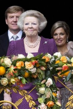 His Majesty King Willem Alexander of the Netherlands, Her Royal Highness Princess Beatrix of the Netherlands and Her Majesty Queen Maxima of the Netherlands appear on the balcony of the Royal Palace to greet the public after her abdication and ahead of texander of The Netherlands