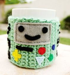 Items similar to BMO Beemo Video Game System Coffee Mug Tea Cup Cozy: Adventure Time -ish Cartoon Kawaii Crochet Knit Sleeve on Etsy Crochet Coffee Cozy, Crochet Cozy, Crochet Geek, Form Crochet, Yarn Projects, Crochet Projects, Sewing Projects, Geek Crafts, Diy And Crafts