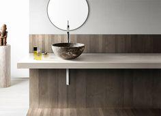 Kreoo Bathroom Sinks - Note floor sweeping up wall to create splash, then quiet wall treatment