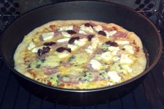 Pizza with olive paste, blue cheese and feta cheese.