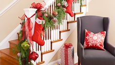 Showcase your family's stockings in a prominent location like this staircase, adding a garland to make it a focal point. -- Lowe's Creative Ideas