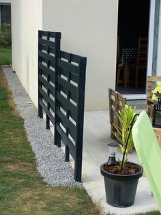 Privacy wall (like the staggered level coming from the house...not color or style)