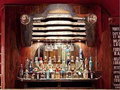 A vintage car grill doubles as a stemware rack. Ok not as a bar but a perfect headboard. Car Part Furniture, Automotive Furniture, Automotive Decor, Furniture Design, System Furniture, Bench Furniture, Furniture Plans, Bar Vintage, Vintage Car Decor