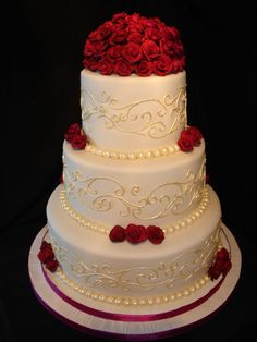 Gold Wedding Cakes wedding cake covered in Cream Fondant. Dusted Ivory pearl balls and painted ivory swirls. Made the roses from Gumpaste and painted with plum coloured dust. Wedding Cake Red, Round Wedding Cakes, Plum Wedding, Elegant Wedding Cakes, Beautiful Wedding Cakes, Wedding Cake Designs, Beautiful Cakes, Beauty And The Beast Wedding Cake, Wedding Ideas