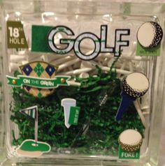 Tee Up - $20 For the golf lover in your life.  This lovely decorated glass block is filled with green grass and 90 golf tees.  Sure to win them over and get them ready for spring.