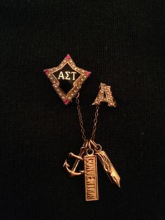 Badge with Alpha guard and Alumnae, Convention and Editor dangles