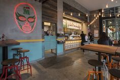 Established brand Mad Mex approached Morris Selvatico to design their prominent corner site at the new East Village in Zetland.