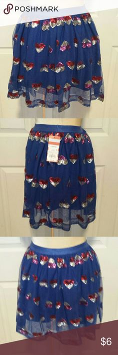 Cat & Jack sequin heart skirt size 10/12 Blue skirt with tulle overlay decorated with red and silver and purple and silver sequin hearts. Thick elastic waistband and there is an additional layer of tulle between skirt and outer layer. Cat & Jack Bottoms Skirts