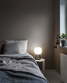 White glass shade creates a soft light in your room.