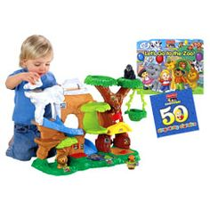"""Little People Zoo Talkers Animal Sounds Zoo Gift Set - #F6109    Kids can place any Little People® Zoo Talkers™ animal in the hut to hear its name and the sound it makes. There are other fun sounds around the zoo, too, with fun action surprises in all four habitats! Gift set collection extends zoo animal fun with a durable """"Let's Go to the Zoo"""" lift-the flap board book, plus a Sing-Along Favorites CD. Zoo includes zookeeper and 3 Zoo Talkers™ animal figures: polar bear, gorilla and lion."""