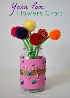 Flower craft for kids using yarn poms and fun products from Creatify. Great spring kids craft | from iheartcraftythings.com