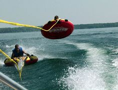 Tubing behind our Pontoon Boat at Patoka Lake, IN - not quite the raft we used, but it was so much fun.