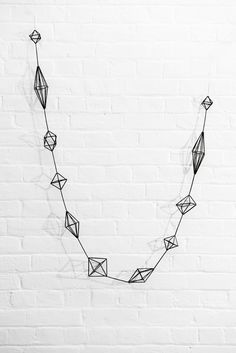 HIMMELI - BRANCH A himmeli garland painted matte black. Measures - long x at widest point. Himmeli means Sky, Heaven… Many years ago himm. Straw Crafts, Diy Straw, Mobiles, Diy And Crafts, Arts And Crafts, Do It Yourself Inspiration, Geometric Decor, Wire Art, Xmas Decorations