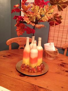 Easy fall/ halloween center just used spray paint on old wine and cider bottles.