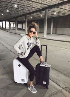 Christine Andrew + simple but stylish + grey Adidas hoodie + black joggers + grey sneakers + sporty chic style + perfect for travelling long journeys Sweater: Adidas. outfit Travel Outfits Airport style: How To Look Fashionable During Travel Comfy Travel Outfit, Travel Outfit Summer, Summer Travel, Comfy Outfit, Plane Travel Outfit, Cute Travel Outfits, Travel Plane, Travel Wear, Outfit Work
