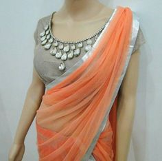 Designer statement sari or saree blouse with embellished stones. Indian fashion.