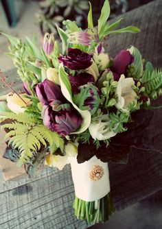 Early spring bridal bouquet with tulips and ferns Keywords: #weddings #jevelweddingplanning Follow Us: www.jevelweddingplanning.com  www.facebook.com/jevelweddingplanning/