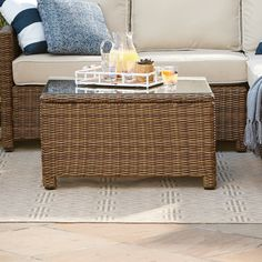 Lawson Wicker Square Coffee Table | Chic and lasting, this coffee table features a heavy-duty steel frame wrapped in all-weather wicker and topped with a glass surface to ensure year-round entertaining.