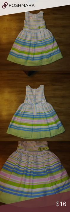 Beautiful Infant Girl's EASTER Dress 18 MONTHS Up for sale is a Beautiful Infant Girl's EASTER Dress Size 18 MONTHS ~~ JESSICA ANN!  This sleeveless dress is mainly white in color with colorful pastel stripes consisting of green, purple and blue! Ties in the back to adjust the tightness! Has a pastel green bow at the waist!   PERFECT for Easter!  Made of 65% Polyester & 35% Rayon!  This dress comes from my clean smoke free and pet free home. No flaws or stains! If you have any questions…