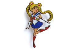 "Sailor Moon fans rejoice! Live out your dreams as a sailor scout. Fight evil by moonlight and win love by daylight in style.--------------------------Limited Edition PinCollector's Item Approximately 2"" x 1.11"" Hard Enamel, Gold Lapel Pins With Screen-printed details Rubber Clutches Comes with a holographic backing card"