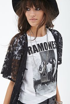 Pay homage to an iconic rock quartet and look effortlessly edgy while you do in this vintage-inspired Ramones™ band tee. Channel the artists themselves and pair it with a faux leather moto jacket and distressed skinnies for the ultimate effortless-cool look.